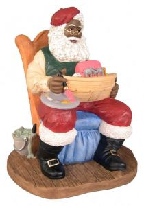 Black Santa Claus Painting a Toy Boat Figurine